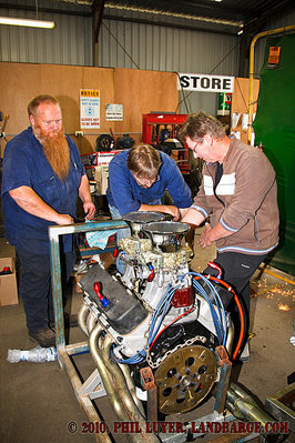 Mick Rumbold, Darrell Horley and Dexter Taylor sort out the fuel line plumbing on the big block Chev