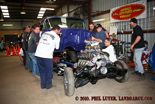 The team lifting the body onto the chassis while Blacky (right) gives valuable advise