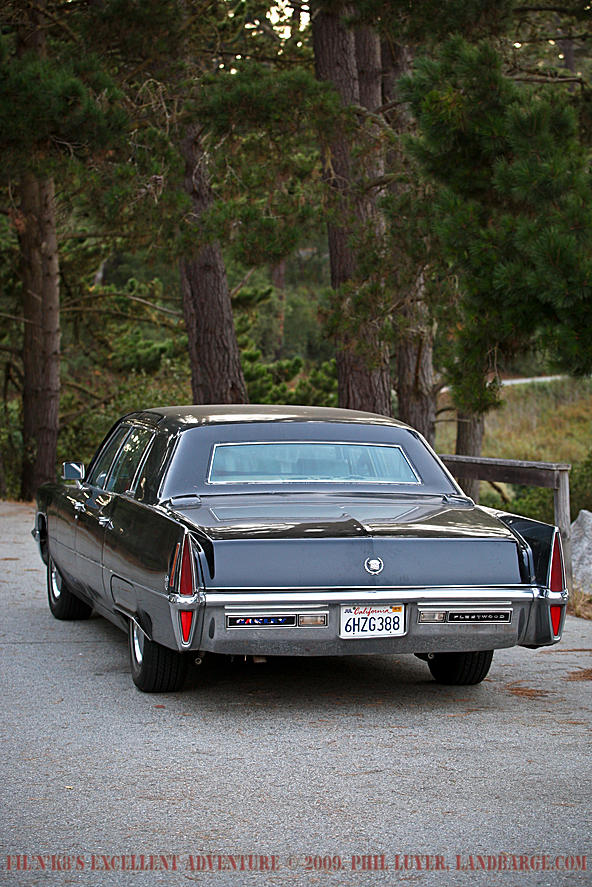 The Cadillac parked on the side of the Pebble Beach's 17 mile drive