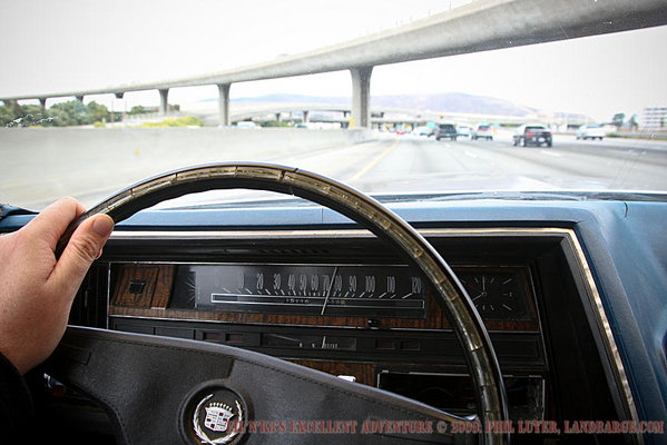 Behind the wheel of the Caddy, on the Interstate.  Photo taken on the way to San Francisco last time we were in the US.